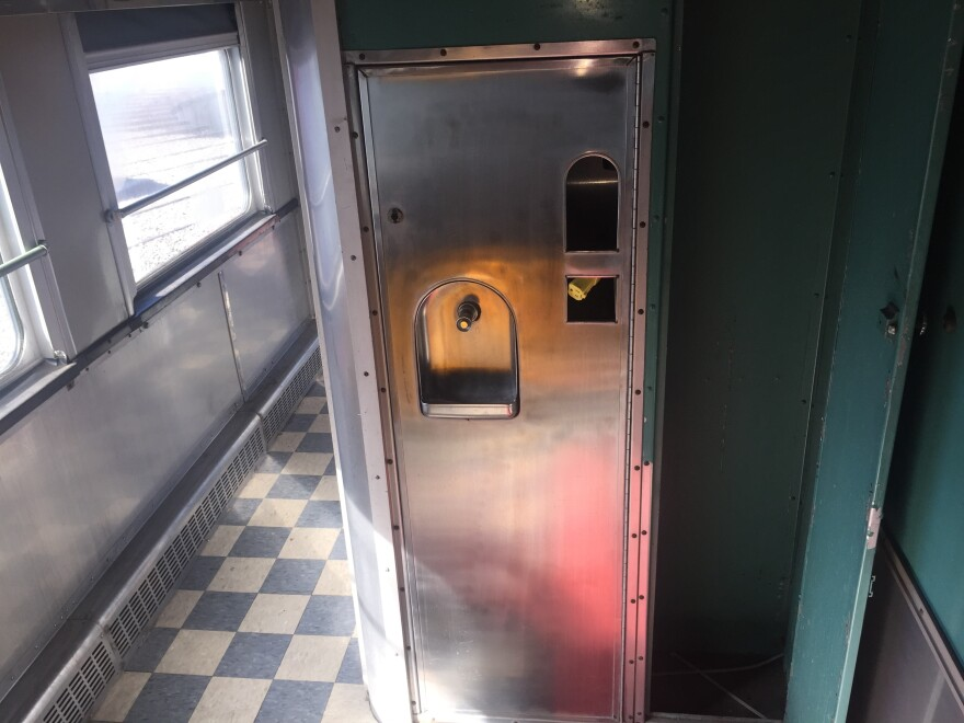 This is where the water fountain for black passengers was located. There would have been an identical one for white passengers on the other side.