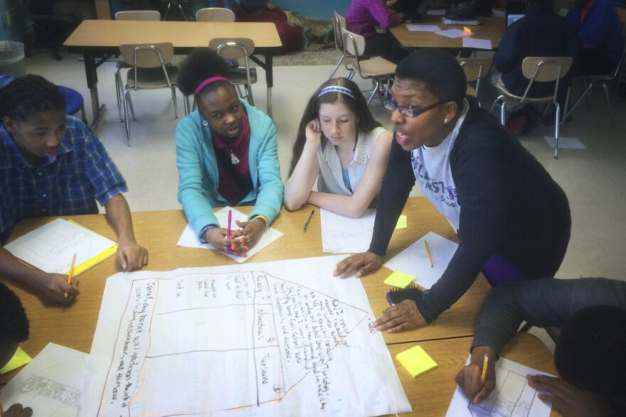 At Nashville's Bailey Middle Prep, Whitney Bradley teaches her 8th-graders how to organize an essay in preparation for the writing section of Tennessee's standardized test. Most in her class trail their peers in literacy.