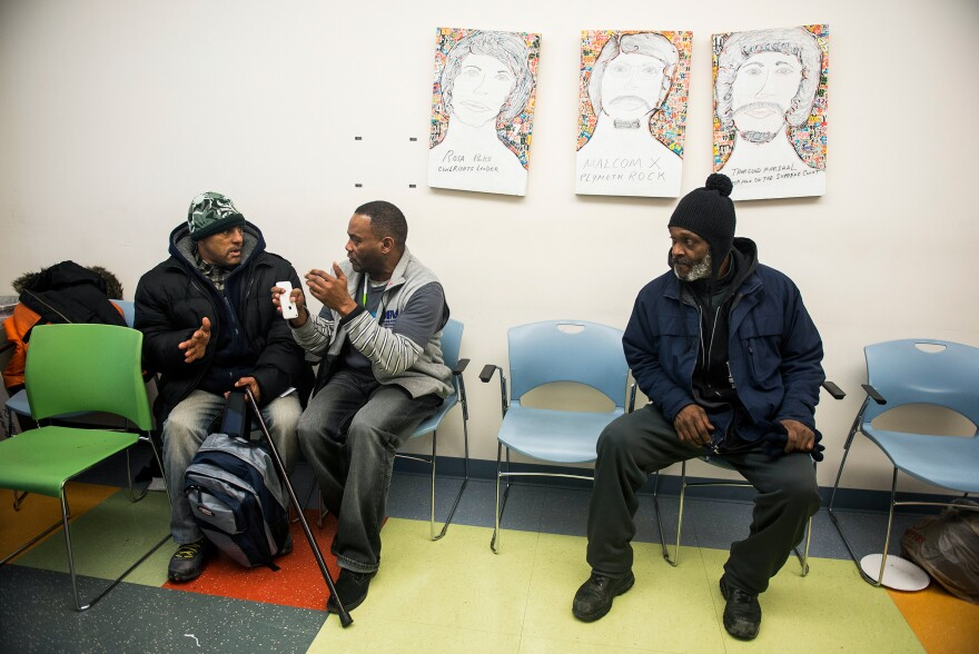 Tony Simmons (center) speaks with Amsted Hetherington during a group meeting about homeless issues at Health Care for the Homeless in Baltimore.