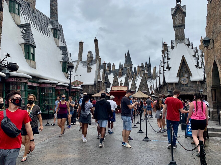 Crowded scene in Hogsmeade at Universal Orlando Resort.