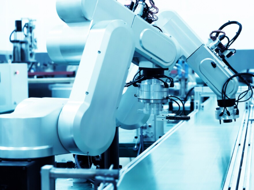 Modern automatic robot assembly line in a factory.