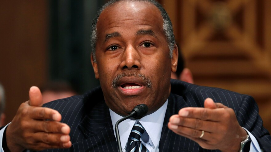 Housing and Urban Development Secretary Ben Carson faces a lawsuit over his agency's sidelining of a rule that is meant to prevent segregation in areas that receive federal housing funds.