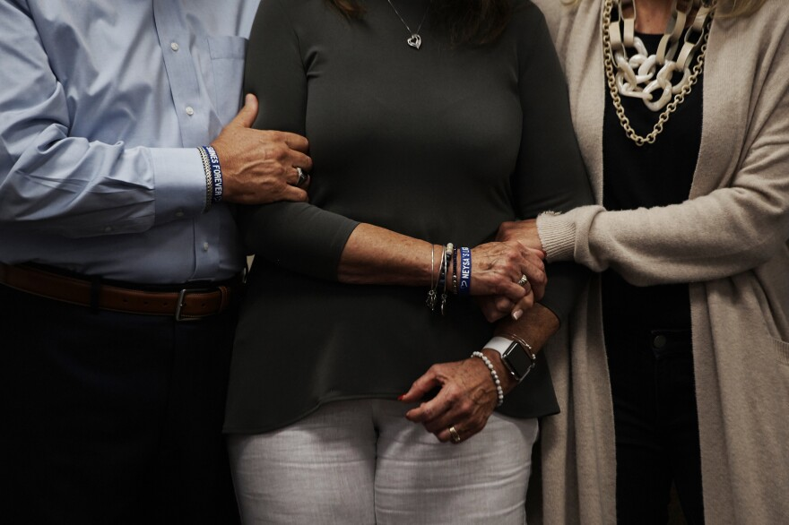 Neysa Tonks' parents, Chris and Debbie Davis, and sister, Mynda Smith, embrace during a news conference for Children of the 58 on Sept. 14, 2018,<strong> </strong>at the College of Southern Nevada in Las Vegas. Tonks was a single mother of three sons.