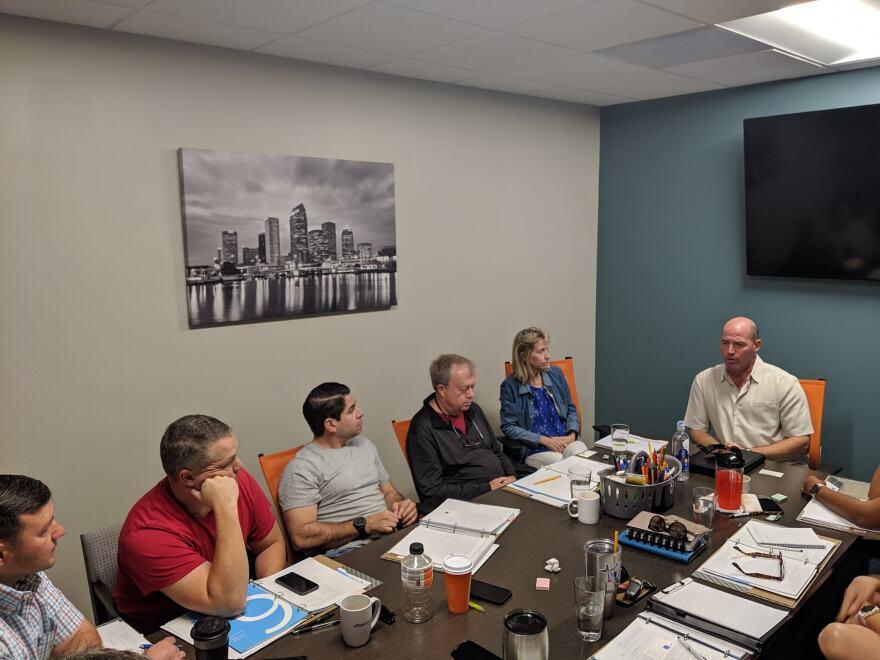 Veteran entrepreneurs sit around a table