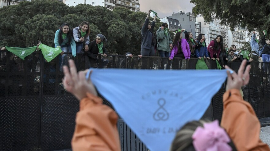 The demand that an Argentine radio show host start hosting programming about gender issues comes against a backdrop of debate about sexism and women's rights in Argentina. In this photo taken in June, pro- and anti-abortion demonstrators are seen outside the Congress building in Buenos Aires.
