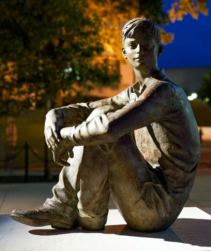 A life-size young Ike looks over at the statues depicting his future.