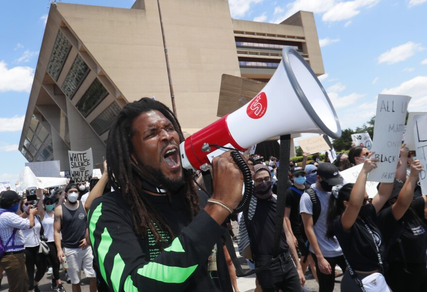 Protesters chant in front of Dallas City Hall in downtown Dallas, Saturday, May 30, 2020.