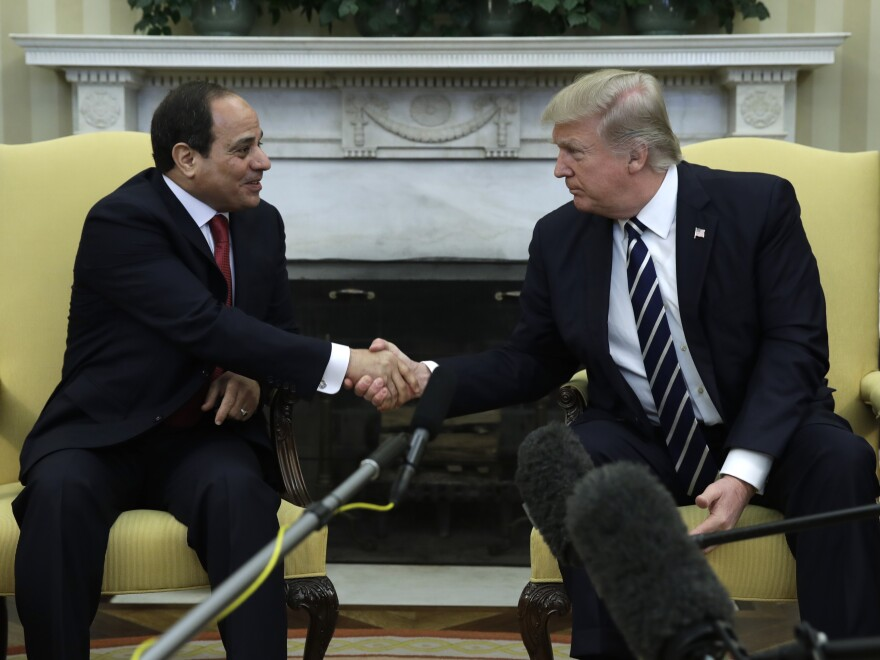 President Trump shakes hands with Egyptian President Abdel Fattah al-Sissi in the Oval Office of the White House last month. Trump praised the job al-Sissi has done.