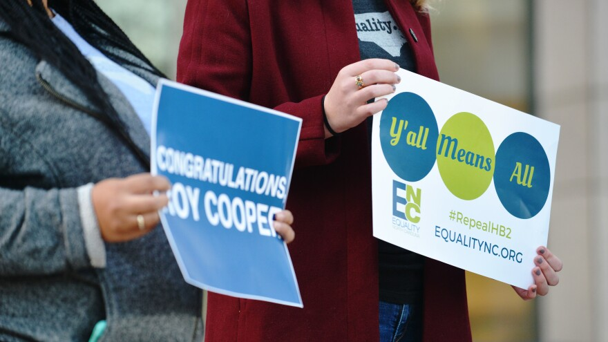 Supporters of Democratic Gov.-elect Roy Cooper and those advocating to repeal HB2 hold signs last month in Charlotte, N.C.