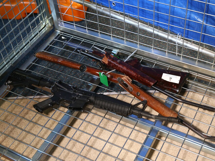Destroyed guns lie in a container during a firearm collection event in Wellington, New Zealand, in July.