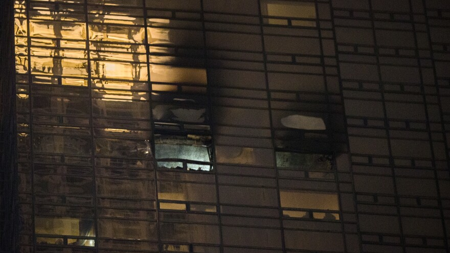 Fire damage is seen on a side of Trump Tower in Manhattan on Saturday. The New York City Fire Department says the blaze broke out on the 50th floor shortly before 6 p.m.