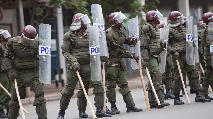 Kenyan police confront university students protesting higher fees on May 20. The police have a reputation for corruption and violence and are not well-liked. But when a popular officer was arrested and charged with a vigilante-style killing, residents took to the streets to support him.