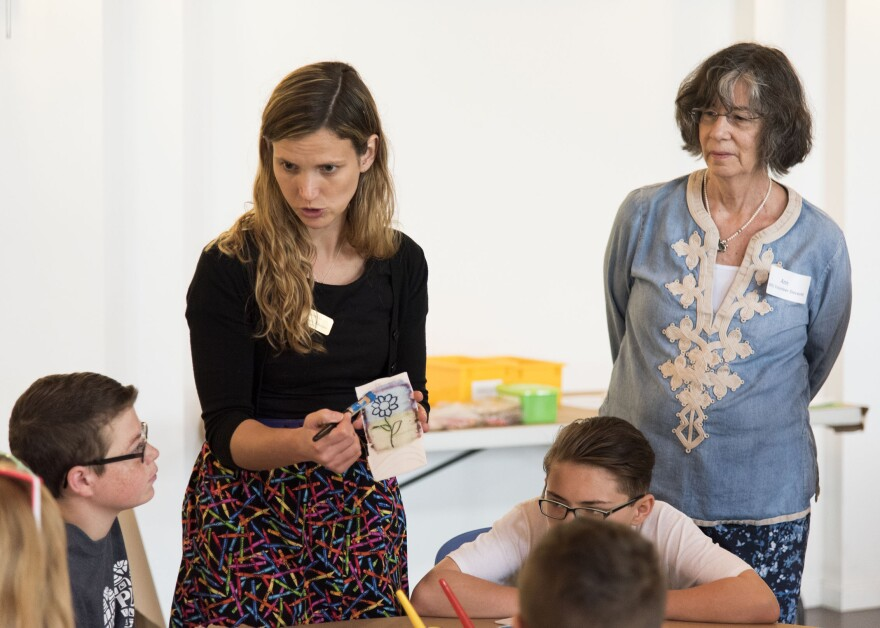 Heather Harris, the WVU art museum's education programs manager, speaks to Barrackville Middle School students earlier this year during a hands-on art exercise following a tour of the collection.