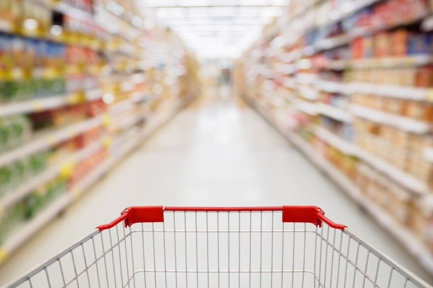Stock photo of a grocery cart in a supermarket.