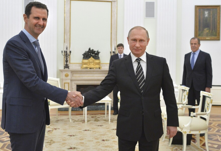 Russian President Vladimir Putin shakes hands with Syrian President Bashar Assad during Tuesday's meeting at the Kremlin in Moscow.