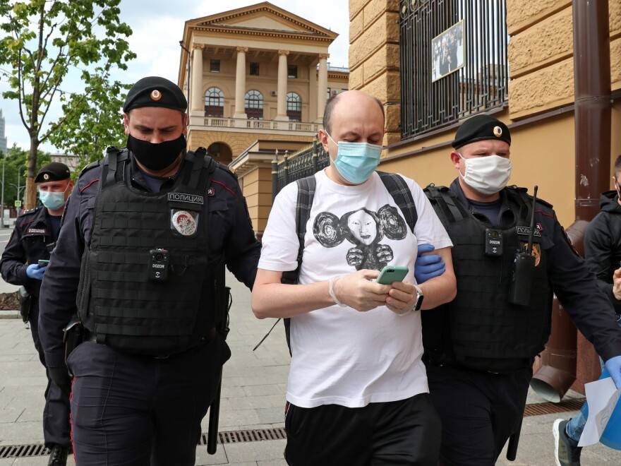 "Sergei Smirnov, pictured being detained at a ""solo protest"" in May 2020, was sentenced to 25 days in jail on Wednesday for allegedly calling on people to protest through a Twitter repost."