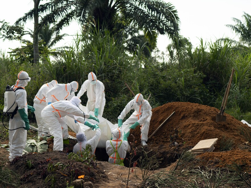 The Democratic Republic of Congo saw the end of its second worst Ebola outbreak in June. More than 2,000 people died in that outbreak. Burial workers, seen above in 2019, follow safe burial practices to mitigate the spread of the virus.