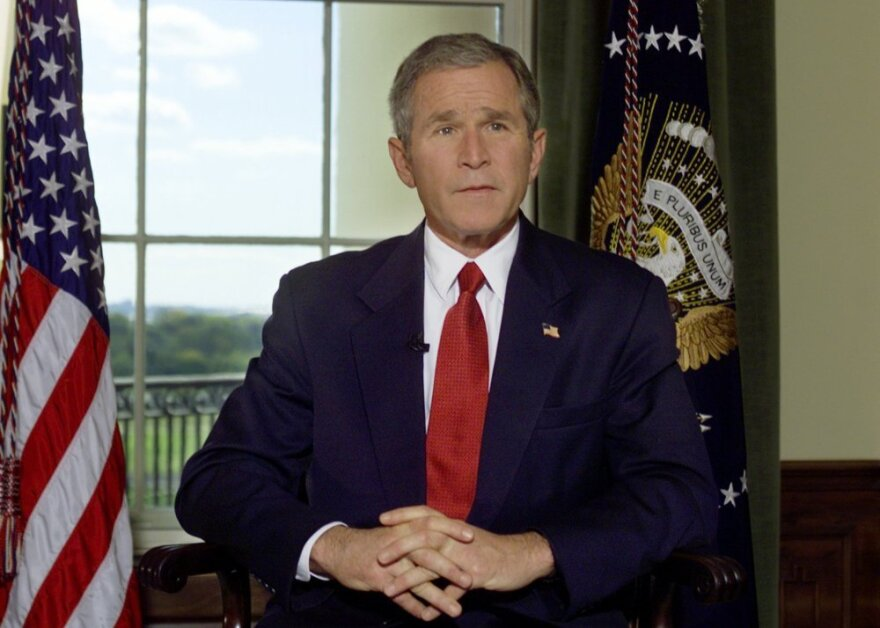 <p>Oct. 7, 2001: President George W. Bush poses for a photo in the Treaty Room of the White House after announcing airstrikes on on Afghanistan.</p>