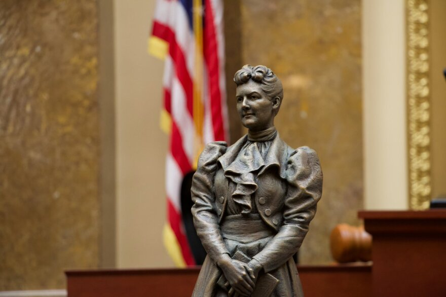 Photo of the statue inside the Utah State Capitol building.