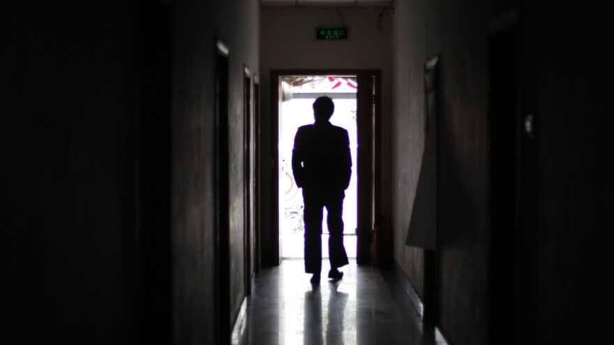 "A man walks through a former unofficial, or ""black,"" jail in Beijing, in 2009. It's estimated that thousands of Chinese lodging protests against the government are illegally detained in secret sites such as this one, even though the government says they don't exist."