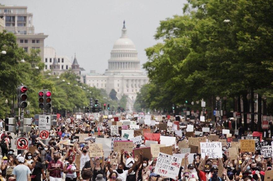 Demonstrators march down Pennsylvania Avenue.
