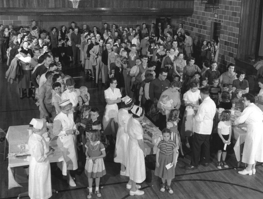 Residents of Protection, Kansas, gathered in the high school gym to receive polio shots on April 2, 1957. The mass inoculation event was staged by the March of Dimes, then known as the National Foundation for Infantile Paralysis.