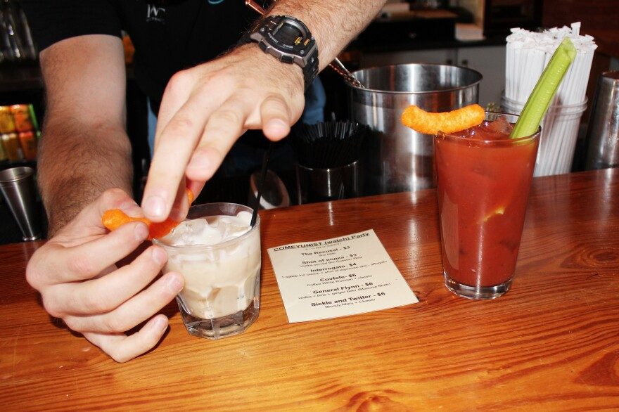 Bartender Mark Sappington prepares a Covfefe drink for the James Comey hearing watch party at Thou Mayest in Kansas City, Mo. The drink is a white Russian garnished with a Cheeto. A Bloody Mary, renamed as the Sickle and Twitter, was also garnished with a Cheeto.
