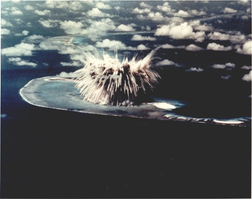 A nuclear bomb explodes on the Enewetok Atoll in the Pacific, where dozens of nuclear tests were conducted in the 1950's and '60's.