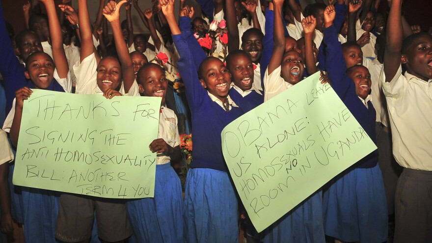 Ugandan students take part in an event Monday to celebrate the signing of a new anti-gay bill outside Kampala, Uganda. Ugandan President Yoweri Museveni signed the bill into law on Monday.