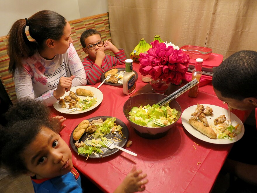Bennie and Ashara Manns, along with their daughter, 4-year-old Jada, and Ashara's nephew, Elliott Jones, 3, gather for a healthy dinner.