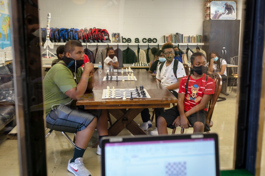 Students in the summer chess program are required to wear masks in class and have the option to wear gloves.