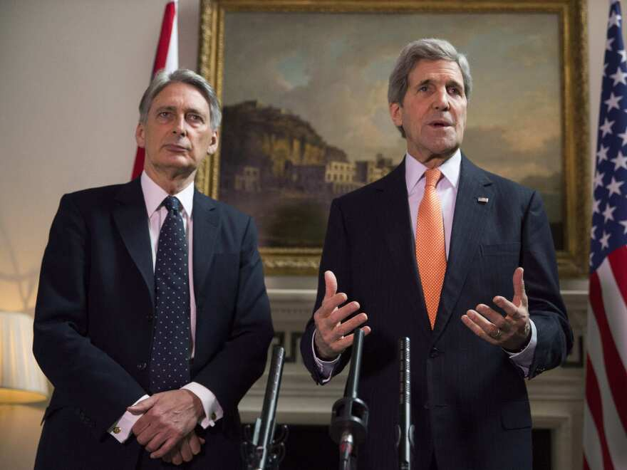 Britain's Foreign Secretary Philip Hammond and Secretary of State John Kerry deliver a statement at a news conference in London, today. Kerry said the two were going to discuss the possibility of further sanctions against Russia amid cease-fire violations in eastern Ukraine.