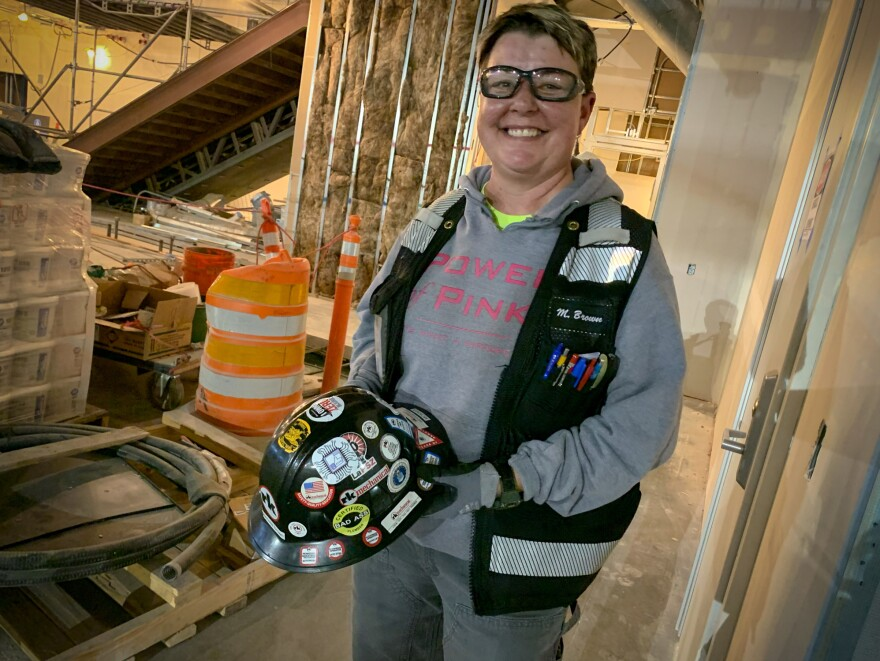 "Over the course of 31 years working in construction, Michelle Brown has endured three co-workers' suicides. Her hard hat bears the name ""Momma,"" recognition of her caring approach on the job."