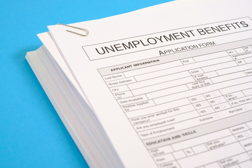 a white unemployment form on a blue background.