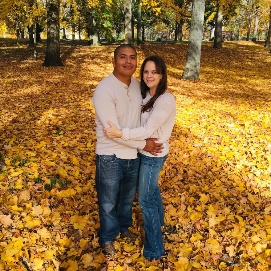 Choco and Jennie Valdez stand in autumn leaves