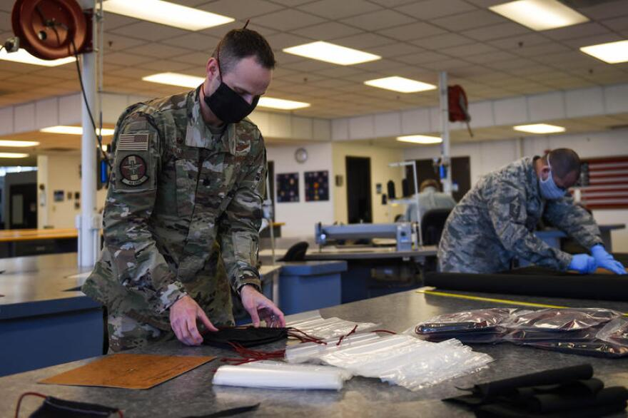 Airmen from the 62nd Operations Support Squadron's aircrew flight equipment (AFE) section at Joint Base Lewis-McChord producing cloth face masks.