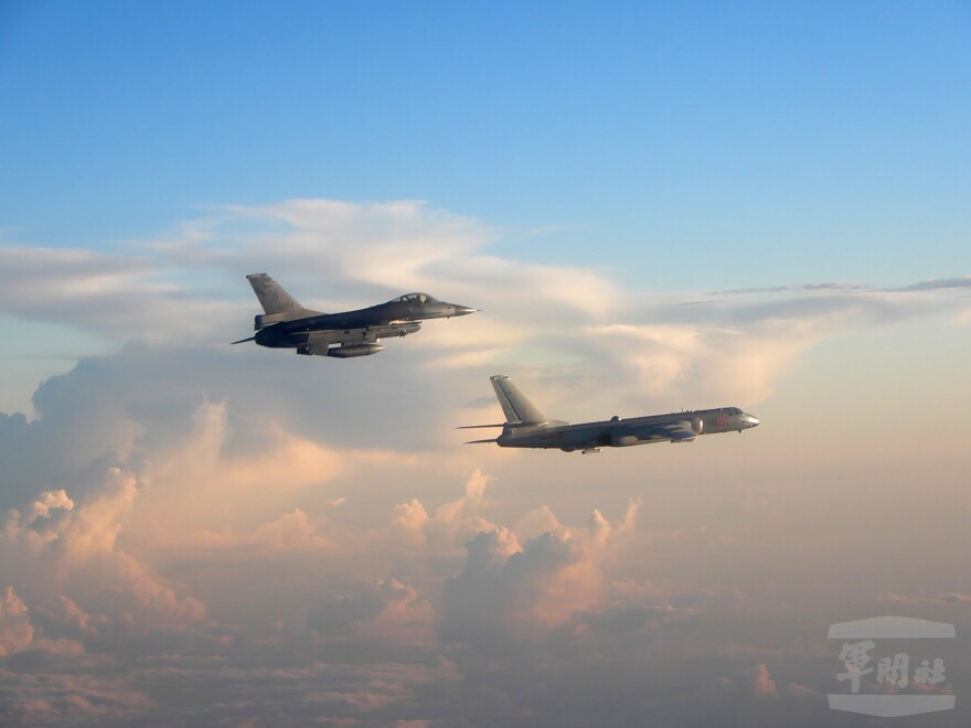 In this photo taken and released Friday by the Taiwan Ministry of National Defense, a Taiwanese Air Force fighter aircraft (left) flies near a Chinese People's Liberation Army Air Force bomber. Taiwanese President Tsai Ing-wen said this week that the island will step up security to respond to military threats from China.