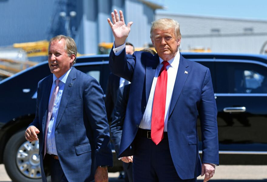 Texas Attorney General Ken Paxton, seen here alongside President Trump in Dallas in June, sued four states that Biden carried in the general election, claiming their changes to election procedures during the pandemic violated federal law.