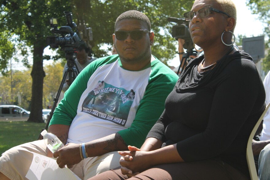 Erica Jones, right, and Theodis Rush, left, listen to a press conference to announce more money for an anti-gun-violence program run out of Better Family Life. Jones's 24-year-old daughter, Whitney Brown, was killed in a drive-by shooting in August.