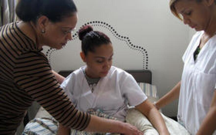 In this 2012 file photo, home health aide trainees Marisol Maldonaldo (center) and Nancy Brown (right), shown here with assistant instructor Miguelina Sosa, are studying to get a job as in-home caregivers.