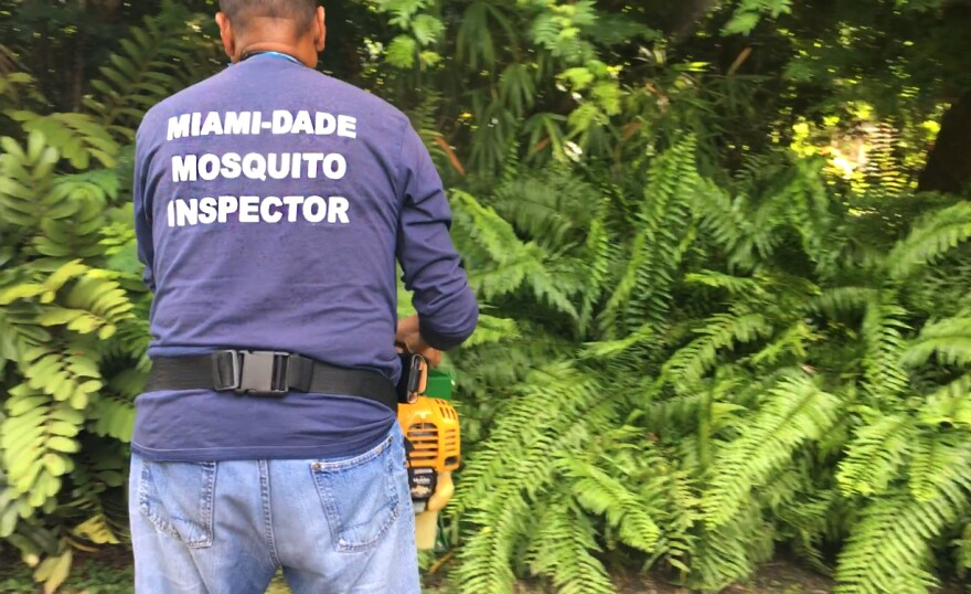 Larry Smart is a mosquito control inspector. He sprays a house in South Florida