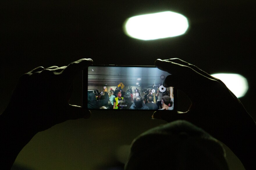 Photo of phone showing exchange between police and protesters.