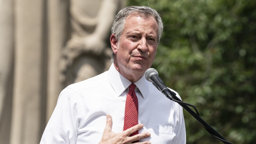 New York City Mayor Bill de Blasio speaks during memorial service for George Floyd on Cadman Plaza on Thursday. De Blasio said on Sunday that New York City would lift its curfew.