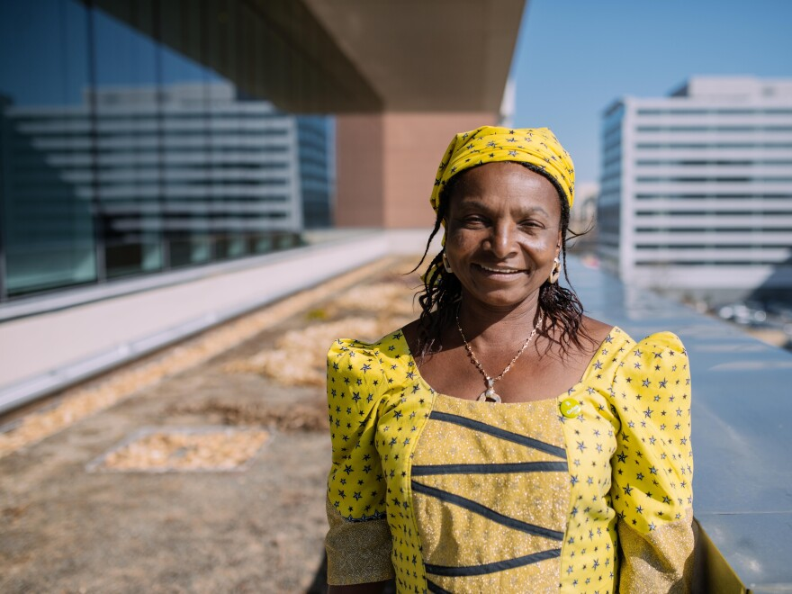 """Monica Maigari, a <em>Female Food Heroes</em> contestant from Nigeria, is visiting Washington, D.C., for the first time on a trip sponsored by Oxfam. She says NPR's rooftop garden, where she is pictured, is """"great for carrots and tomatoes."""""""