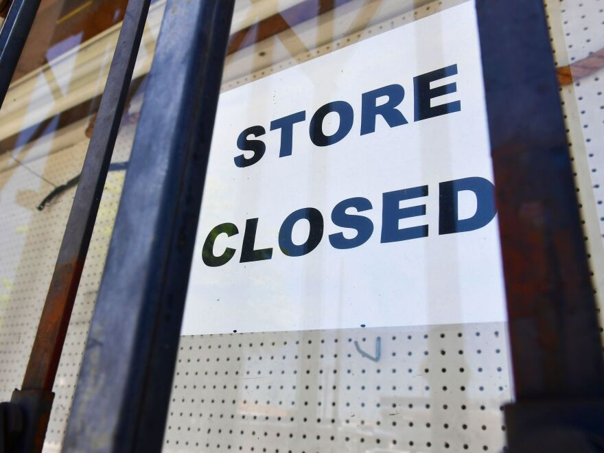 "A ""store closed"" sign is posted at a store in Los Angeles on July 16, 2020. The U.S. economy slowed sharply in the last three months of the year from the previous quarter as the pandemic made a resurgence."