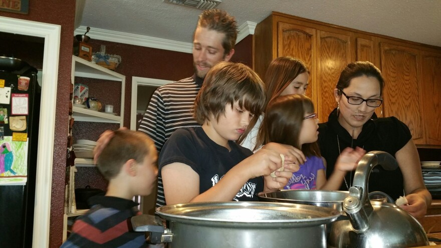 Stephanie and Brian Packer make lunch with their children, Brian, 11, Savannah, 5, Scarlett, 10, and Jacob, 8.