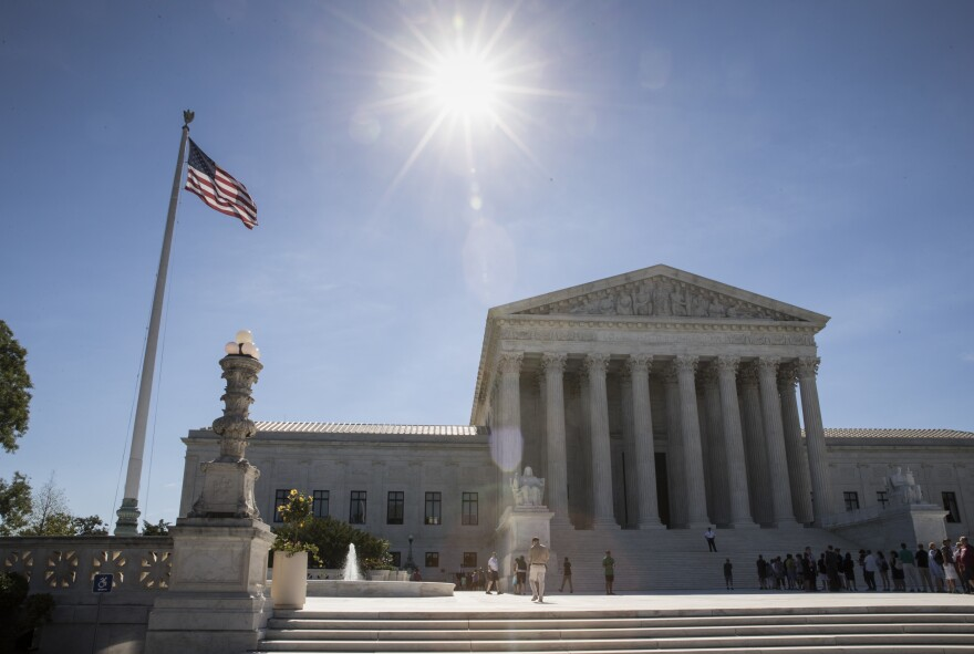 The Supreme Court left in place a lower court's broadened definition of close family members who could be exempt from the travel ban, including the grandparents and cousins of a person in the U.S.