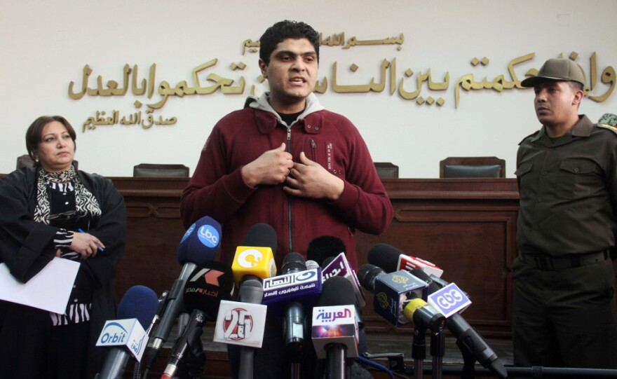 Egyptian army doctor Ahmed Adel speaks during a news conference at a military court in Cairo on March 11. Charged in the case of forced virginity tests on Egyptian protesters last year, he was acquitted.