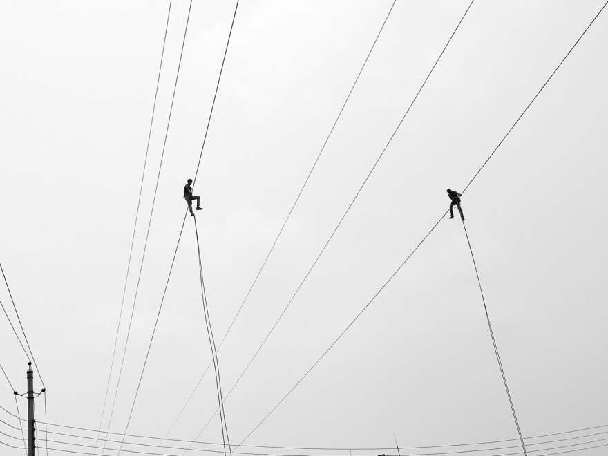 Electricians work on a high wire in Dhaka, the capital of Bangladesh.