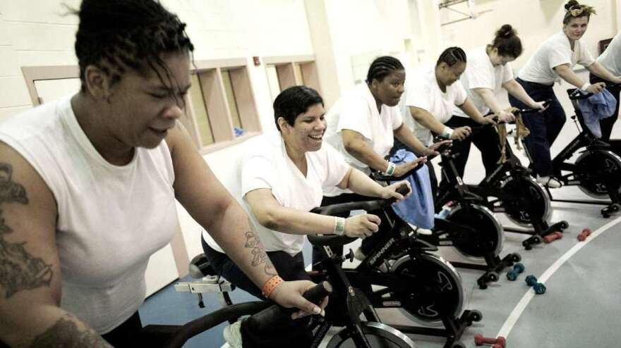 Women incarcerated at the Riverside Correctional Facility in Philadelphia take part in a spinning class run by Gearing Up. Amanda Cortes (second from left) lost 90 pounds in a year.